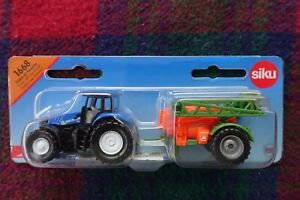 SIKU 1668 1/87 New Holland T8 390 tractor towing Amazone boom crop sprayer (MIB)