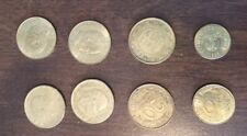 Lot of 8 gold colored coins all foreign Italy, France, Colombia