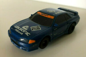 AFX TOMY NISSAN R32 SKYLINE CALSONIC SLOT CAR WITH WORKING HEADLIGHTS.