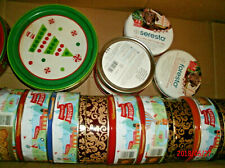 Two dozen plus or minus round covered tins to hold your homemade gifts.