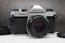 - Pentax K1000 35mm SLR Camera w Pentax-A 50mm f2 Lens