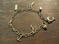 HALLMARKED 9ct GOLD CHARM BRACELET 5.24 grams 7 1/2 INCH LONG 7 FIXED CHARMS