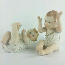 German Arnart Porcelain Piano Baby Set of 2