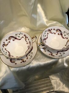 ROYAL TARA TWO HANDLE CUP AND SAUCER. TWO IN THIS SET