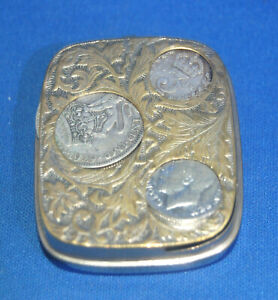 An antique coin holder case, silver plated, 19th century sprung divisions, chain