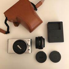 Nikon 1 J1 10.1MP Digital Camera in Silver Kit w/ 2 Lense VR 10-30mm & 10mm