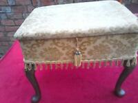 Vintage gold coloured sewing knitting craft box on wooden Queen Anne style legs