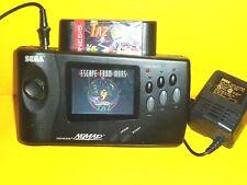 Sega  Nomad Portable Handheld With power Adapter & taz game catridge works great