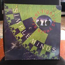 33 TOURS / LP ALBUM GATEFOLD--SIMPLE MINDS--STREET FIGHTING YEARS--1989