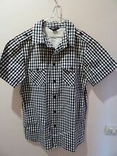 chemise carreaux noir  et blanc 13-14 ans