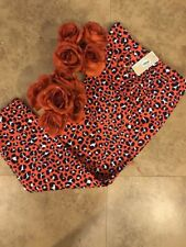 Michael Kors Crop pants Vibrant orange /Blue print. Size 8 New with Tags .