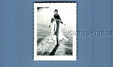 FOUND B&W PHOTO A_5421 MAN IN WATER BY WOMAN FROM BEHIND