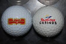 SET of  2  GOLF BALL LOGO QUEEN & SUNCRUZ CASINO