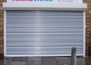 steel electric roller shutter door measuring 3000 mm wide & 2400 mm high