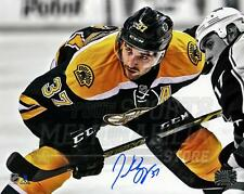 Patrice Bergeron Boston Bruins Signed Autographed Spotlight Faceoff 8x10