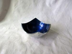 AN ALUMINIUM AND ENAMEL DEEP BLUE DISH