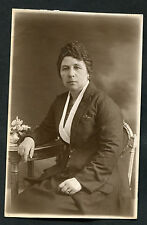 C1920s Photo Card: Portrait View of Lady Sitting at Table in a Suit
