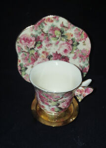 A SPECIAL PLACE DEMITASSE CUP & SAUCER, PINK FLORAL MOTIF WITH BUTTERFLY HANDLE