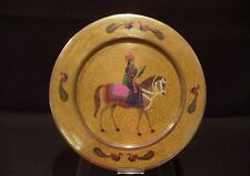 MIDDLE EASTERN EMBOSSED ENAMEL CHARGER OF A ' PRINCE ON HORSEBACK '