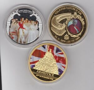 THREE VARIOUS GOLD & SILVER PLATED MEDALS WITH CAPSULES.
