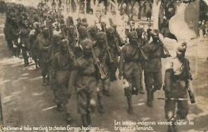 1917 VINTAGE INDIAN SOLDIERS MARCHING to CHASTEN GERMAN HOOLIGANS POSTCARD