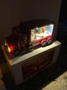 "Animated Lighted Christmas Tree Village 10"" Long Santa Train Semi Red Truck"