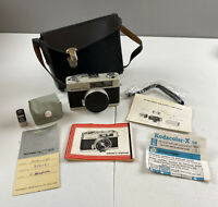 Konica C35 Camera With Cube Flash, Manual, And Case Untested