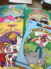 Uncut Golden paper doll book lot Poochie, Monchhichi, Rainbow Brite, and Rainbow