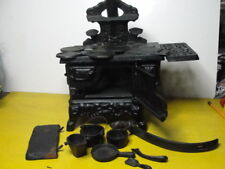 OLD CAST IRON TOY STOVE W/ LOTS OF PARTS