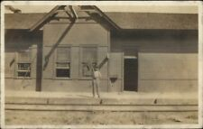Chillicothe IL Written on Back Boy Holding Flag in Front RR Depot Station RPPC
