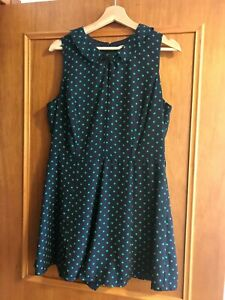 Navy and green polka dot sleeveless jumpsuit or playsuit. Review brand. Size 14