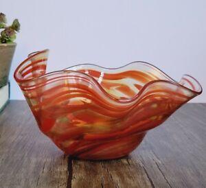 Orange swirl art glass bowl signed James Hayes 7-inches diameter