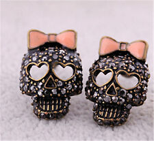 Cool black crystal skull with pink bow stud earrings