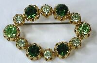 Vintage Signed Austria Brooch Pin Oval Rhinestone Green Prong Set Gold Tone