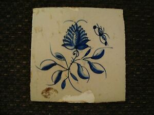 Antique Delft blue and white tile depicting flower and insect  21/449B