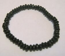 Lovely black small elasticated seed like beaded bracelet dainty and gorgeous