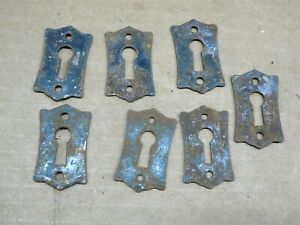 SET of SEVEN OLD METAL HOUSE DOOR KEYHOLE ESCUTCHEON PLATES NEVER USED RUSTY