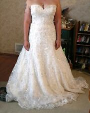 Wedding Dress size 8 worn once ivory with sequin detail. Gorgeous dress.