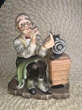 Coll.Figurine man at Sewing Machine threading needle