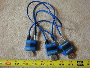 3 Mossberg shotgun, rifle, pistol, handgun, bicycle cable locks. separate keys