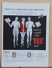 1958 magazine ad for BVD underwear - Woman in Santa dress & underwear men models