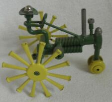 metal folk art sculpture of tractor