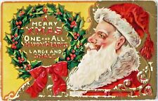 Antique Christmas~SANTA CLAUS RELAXES, SMOKES PIPE~WREATH~GOLD EMBOSSED Postcard