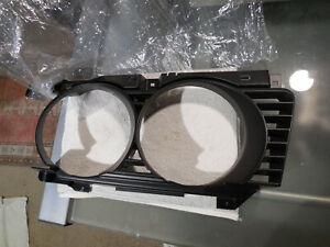 BMW E34 535i left front wide type headlamp grill/surround # 51 13 8 186 441, new