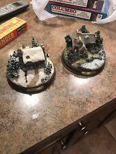 2 Thomas Kinkade Lught Up Figurines