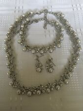 silver necklace/bracelet/earrings with 40 pearls and 80 cubic zirconia stunning