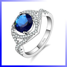 GORGEOUS STERLING SILVER RING with ROUND BLUE and MULTIPLE SMALL CLEAR ZIRCONS