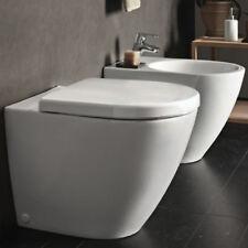 Sanitari filo parete Pozzi Ginori serie Fast bidet e vaso con sedile avvolgente