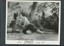 ROCK HUDSON + CYD CHARISSE IN ROMANTIC EMBRACE ON TROPICAL ISLAND - 1958