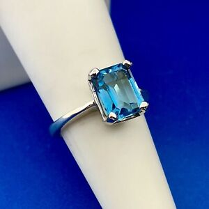 14K White Gold Emerald Cut Blue Topaz Solitaire Ring Stylish